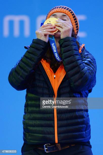 Gold medalist Bibian MentelSpee of Netherlands celebrates during the medal ceremony for Women's Snowboard Cross Standing on day seven of the Sochi...