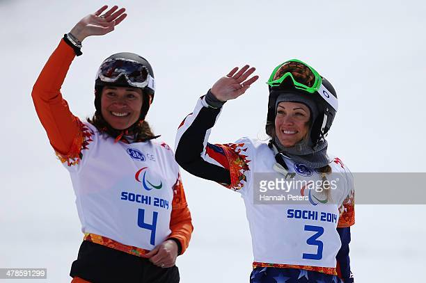 Gold medalist Bibian MentelSpee of the Netherlands and bronze medalist Amy Purdy of the United States celebrate during the flower ceremony for the...