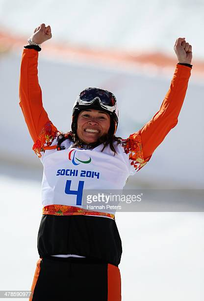Gold medalist Bibian MentelSpee of the Netherlands celebrates during the flower ceremony for the Women's Para Snowboard Cross Standing on day seven...