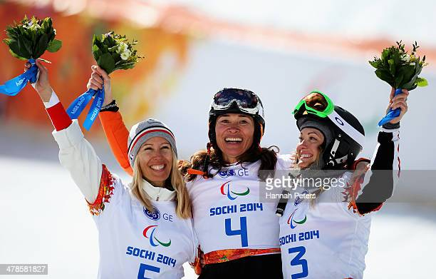 Gold medalist Bibian MentelSpee of the Netherlands poses with silver medalist Cecile Hernandez Ep Cervellon of France and bronze medalist Amy Purdy...