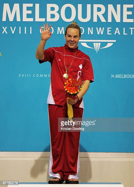 Gold medalist Blythe Hartley of Canada salutes the crowd after the Women's 3m Springboard Final during the diving at the Melbourne Sports Aquatic...