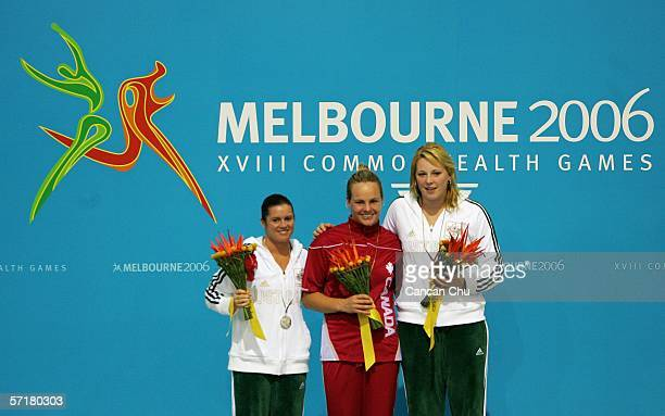 Gold medalist Blythe Hartley of Canada stands on the podium with fellow medalists Kathryn Blackshaw of Australia and Chantelle Newbery of Australia...