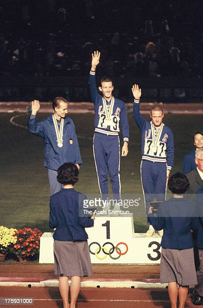 Gold medalist Bob Schul of United States Silver medalist Harald Norpoth of Germany and Bronze medalist Bill Dellinger of the United States pose on...