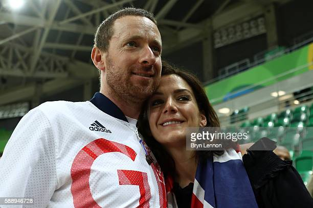 Gold medalist Bradley Wiggins of Team Great Britain and his wife Catherine pose for photographs after at the medal ceremony for the Men's Team...