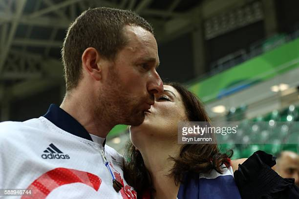 Gold medalist Bradley Wiggins of Team Great Britain and his wife Catherine kiss after at the medal ceremony for the Men's Team Pursuit Final for Gold...
