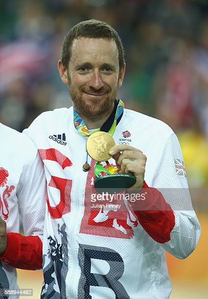 Gold medalist Bradley Wiggins of Team Great Britain poses for photographs after at the medal ceremony for the Men's Team Pursuit on Day 7 of the Rio...