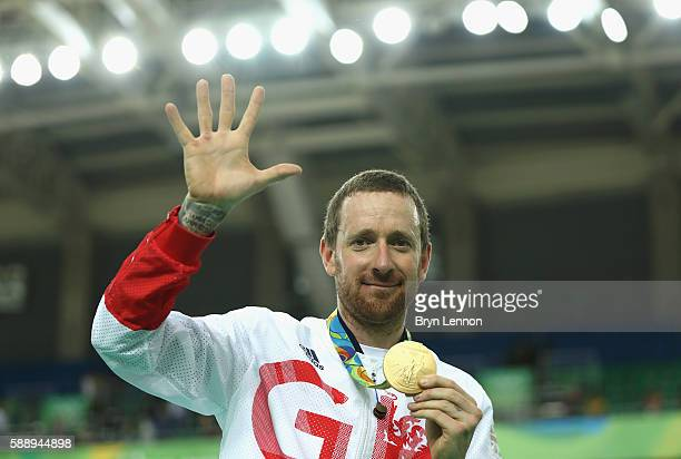 Gold medalist Bradley Wiggins of Team Great Britain poses for photographs with his fifth gold medal in his career after at the medal ceremony for the...
