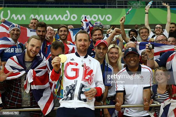 Gold medalist Bradley Wiggins of Team Great Britain poses for photographs with fans after at the medal ceremony for the Men's Team Pursuit on Day 7...
