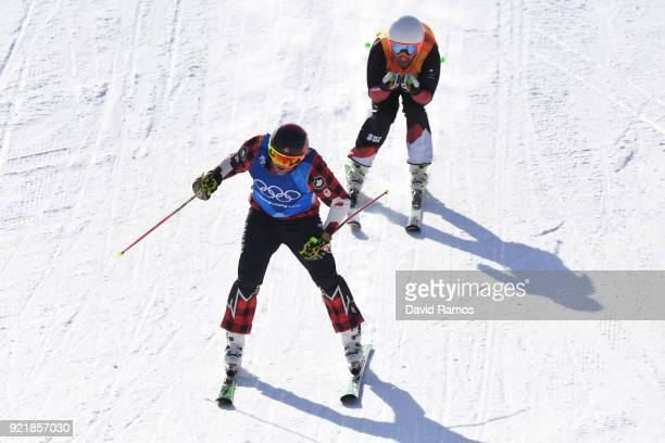 Gold medalist Brady Leman of Canada celebrates as he crosses the finish infront of silver medalist Marc Bischofberger of Switzerland in the Freestyle...