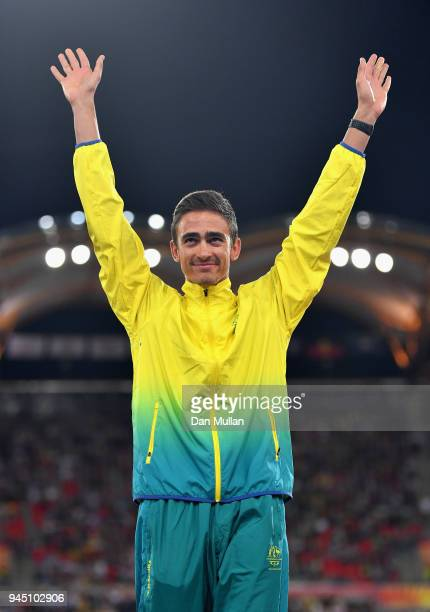 Gold medalist Brandon Starc of Australia celebrates during the medal ceremony for the Men's High Jump during athletics on day eight of the Gold Coast...