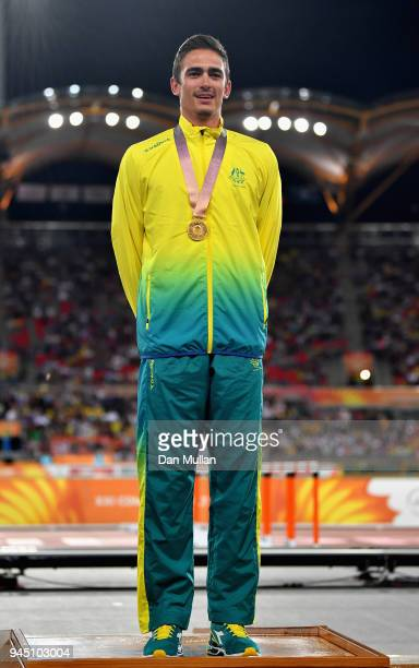 Gold medalist Brandon Starc of Australia looks on during the medal ceremony for the Men's High Jump during athletics on day eight of the Gold Coast...