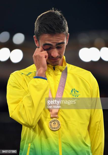 Gold medalist Brandon Starc of Australia shows his emotions during the medal ceremony for the Men's High Jump during athletics on day eight of the...