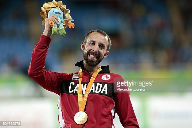 Gold medalist Brent Lakatos of Canada celebrates on the podium at the medal ceremony for the Menâs 100m â T53 Final during day 2 of the Rio 2016...