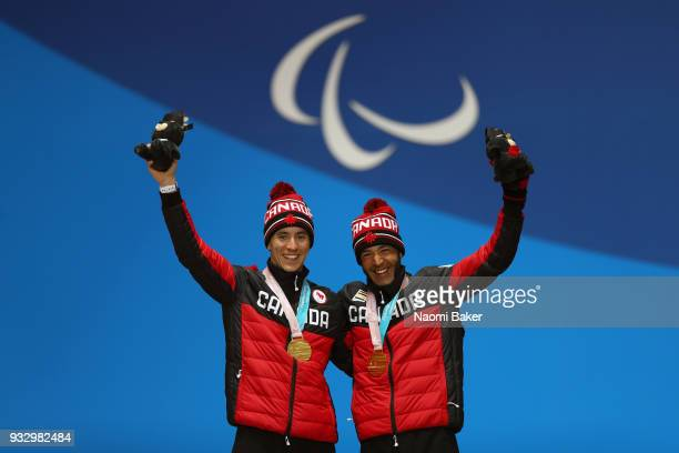 Gold medalist Brian McKeever of Canada and his guide Graham Nishikawa celebrate during the medal ceremony for the Men's 10 km Visually Impaired...