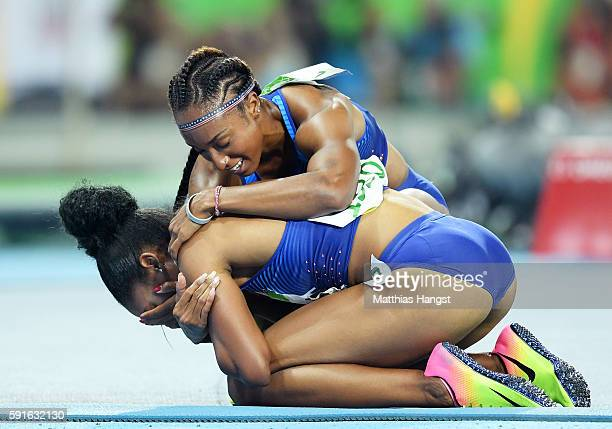 Gold medalist Brianna Rollins of the United States and bronze medalist Kristi Castlin of the United States celebrate after the Women's 100m Hurdles...