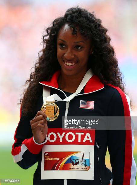 Gold medalist Brianna Rollins of the United States poses on the podium during the medal ceremony for the Women's 100 metres Hurdlesduring Day Nine of...