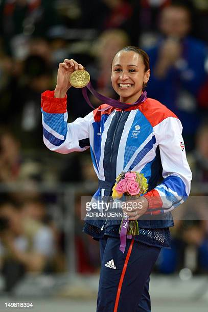 Gold medalist Britain's Jessica Ennis celebrates on the podium of the heptathlon at the athletics event during the London 2012 Olympic Games on...
