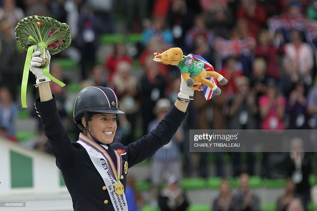 Gold medalist British Charlotte Dujardin celebrates on the podium during the medal ceremony of the Individual Dressage Grand Prix of the 2014 FEI World Equestrian Games at D'Ornano Stadium in the northwestern French city of Caen on August 27, 2014.