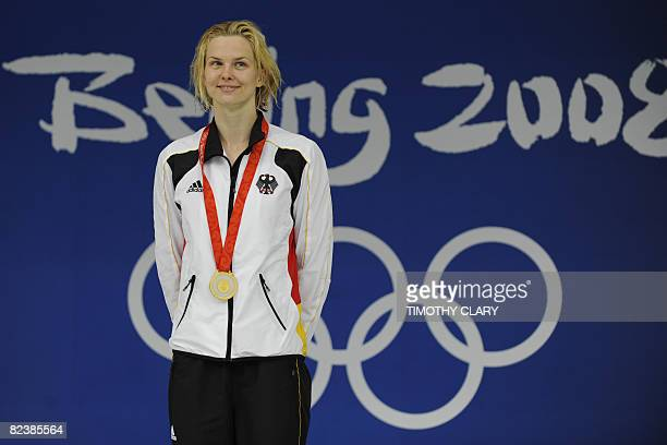 Gold Medalist Britta Steffen of Germany stands on the podium during the women's 50m freestyle swimming final medal ceremony at the National Aquatics...