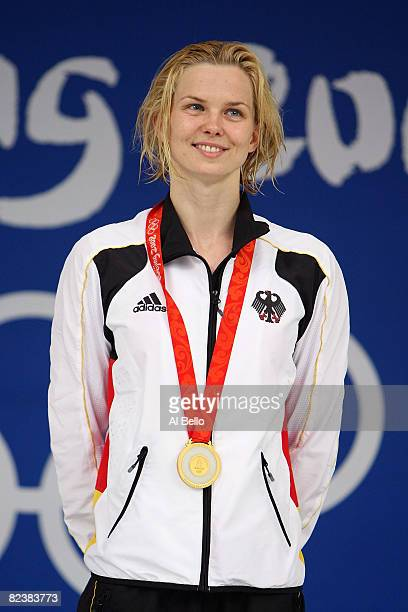 Gold medalist Britta Steffen of Germany stands on the podium with her medal from the Women's 50m Freestyle held at the National Aquatics Centre...