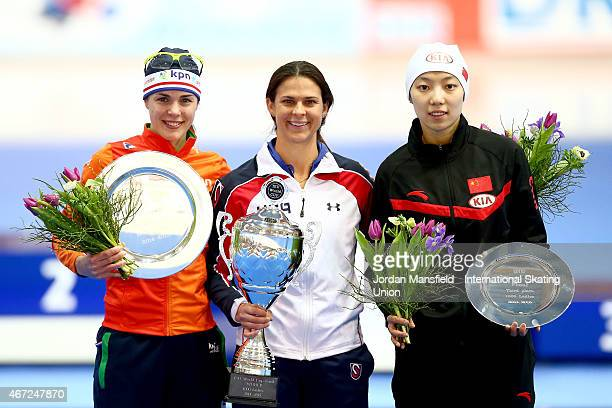 Gold medalist Brittany Bowe of the USA Silver medalist Marrit Leenstra of the Netherlands and Bronze medalist Qishi Li of China pose for a photo...