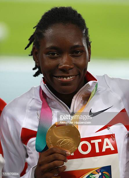 Gold medalist Brittney Reese of United States celebrates on the podium with her medal after the women's long jump final during day two of the 13th...