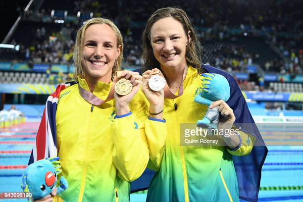Gold medalist Bronte Campbell of Australia and silver medalist Cate Campbell of Australia pose during the medal ceremony for the Women's 100m...