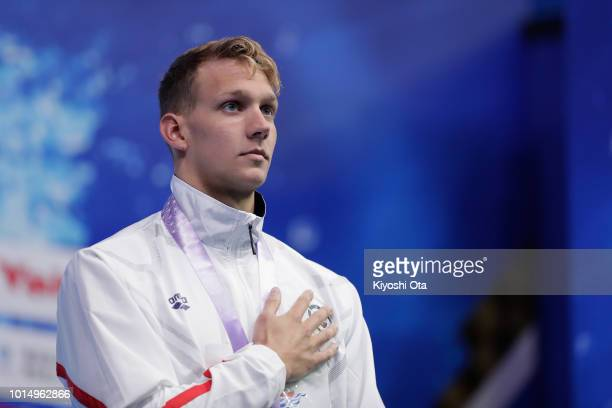 Gold medalist Caeleb Dressel of the United States stands on the podium at the medal ceremony for the Men's 100m Butterfly on day three of the Pan...