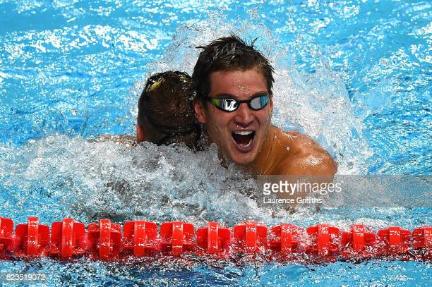 Gold medalist Caeleb Remel Dressel of the United States and silver medalist Nathan Adrian of the United States celebrate following the Men's 100m...