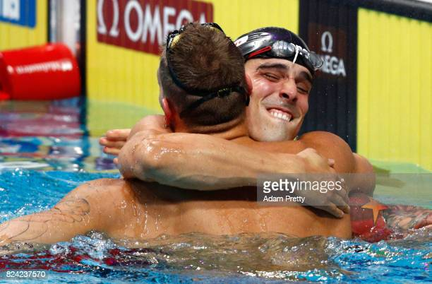 Gold medalist Caeleb Remel Dressel of the United States celebrates with silver medalist Bruno Fratus of Brazil during the Men's 50m Freestyle final...
