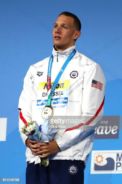 Gold medalist Caeleb Remel Dressel of the United States poses with the medals won during the Men's 50m Freestyle final on day sixteen of the Budapest...