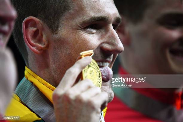 Gold medalist Cameron Van Der Burgh of South Africa poses during the medal ceremony for the Men's 50m Breaststroke Final on day five of the Gold...