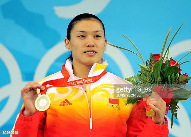 Gold medalist Cao Lei of China poses during the medal ceremony for the women's 75 kg weightlifting event during the 2008 Beijing Olympic Games on...