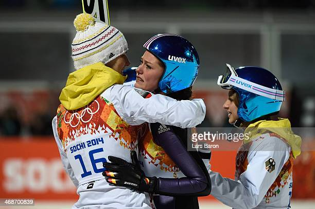 Gold medalist Carina Vogt of Germany is congratulated for winning the gold medal by Ulrike Graessler Gianina Ernst of Germany after the Ladies'...