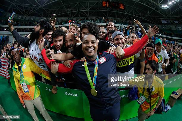 Gold medalist Carmelo Anthony of the United States celebrates after defeating Serbia during the Men's Gold medal game on Day 16 of the Rio 2016...