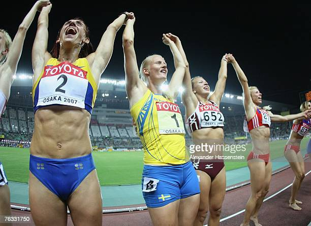 Gold medalist Carolina Kluft of Sweden leads the field in a lap of honour following the 800m during the Women's Heptathlon on day two of the 11th...