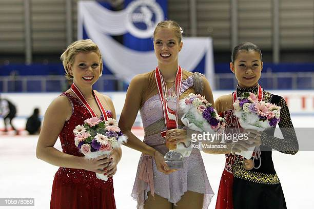 Gold medalist Carolina Kostner of Italy silver medalist Rachael Flatt of the United States and bronze medalist Kanako Murakami of Japan pose after...