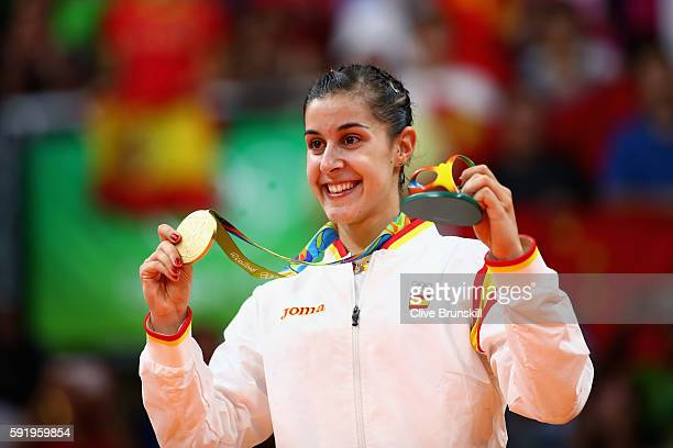 Gold medalist Carolina Marin of Spain celebrates during the medal ceremony after the Women's Singles Badminton competition on Day 14 of the Rio 2016...
