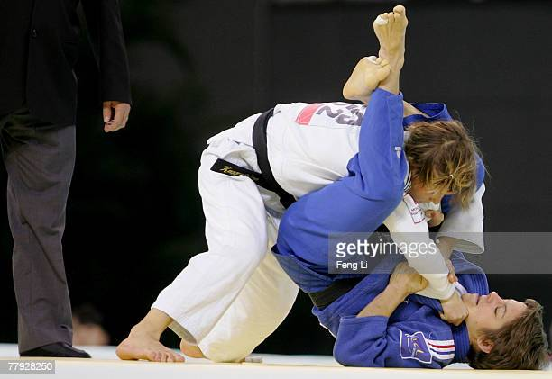 Gold medalist Caroline Lantoine of France competes with Natalia Kuzyutina of Russia in the women's 52kg category during the Good Luck Beijing 2007...