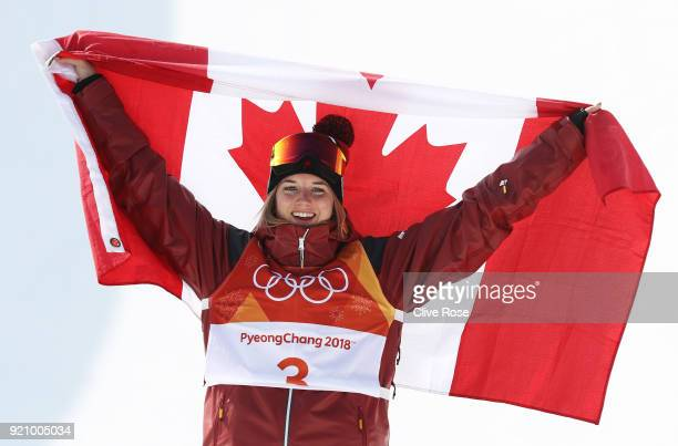 Gold medalist Cassie Sharpe of Canada celebrates on the podium following the Freestyle Skiing Ladies' Ski Halfpipe Final on day eleven of the...