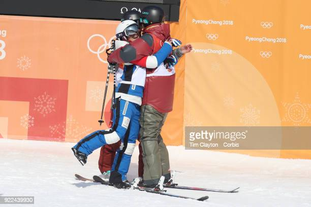Gold medalist Cassie Sharpe of Canada is congratulated by silver medalist Marie Martinod of France and bronze medalist Brita Sigourney of the United...