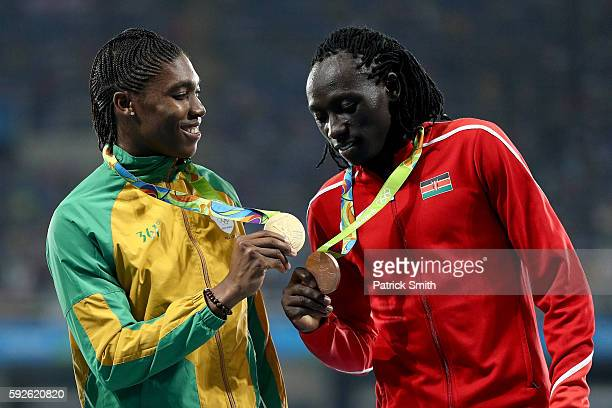 Gold medalist Caster Semenya of South Africa and bronze medalist Margaret Nyairera Wambui of Kenya stand on the podium during the medal ceremony for...