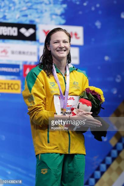 Gold medalist Cate Campbell of Australia celebrates on the podium at the medal ceremony for the Women's 100m Freestyle on day two of the Pan Pacific...