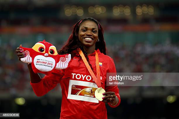 Gold medalist Caterine Ibarguen of Colombia poses on the podium during the medal ceremony for the Women's Triple Jump final during day three of the...