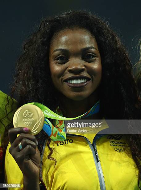 Gold medalist Caterine Ibarguen of Colombia poses on the podium during the medal ceremony for the Women's Triple Jump on Day 10 of the Rio 2016...