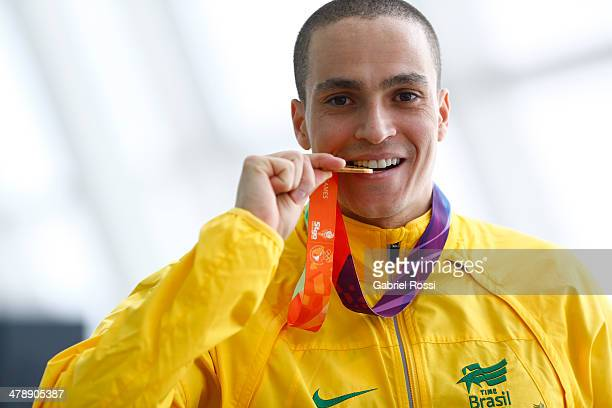 Gold medalist Cesar Aquino de Castro of Brazil in the podium of Men's 3m Springboard Diving during day nine of the X South American Games Santiago...