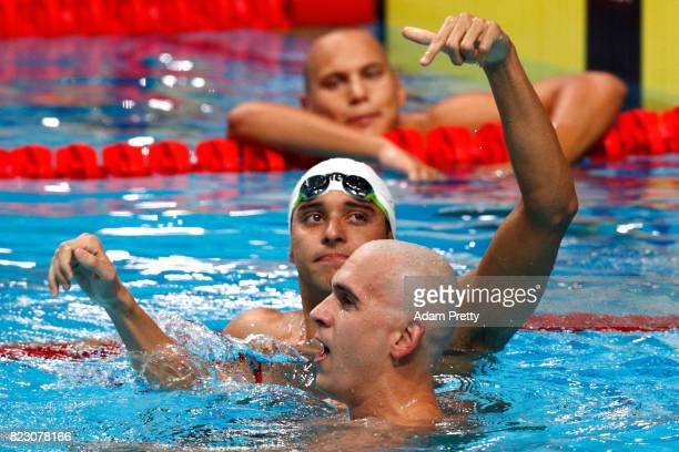Gold medalist Chad Le Clos of South Africa and silver medalist Laszlo Cseh of Hungary celebrate following the Men's 200m Butterfly final on day...