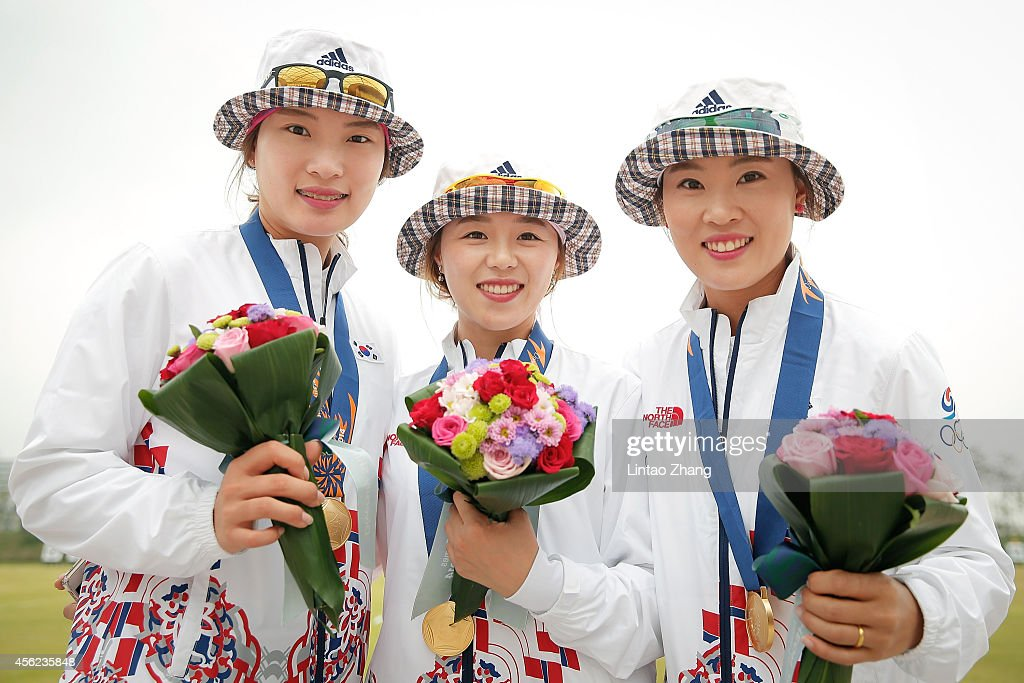 Gold medalist Chang Hyejin, Jung Dasomi and LeeTukyoung pose with their medals after Archery Recurve Women's Team Gold Medal Match in day nine during the 2014 Asian Games at Gyeyang Asiad Archery Field on September 28, 2014 in Incheon, South Korea.