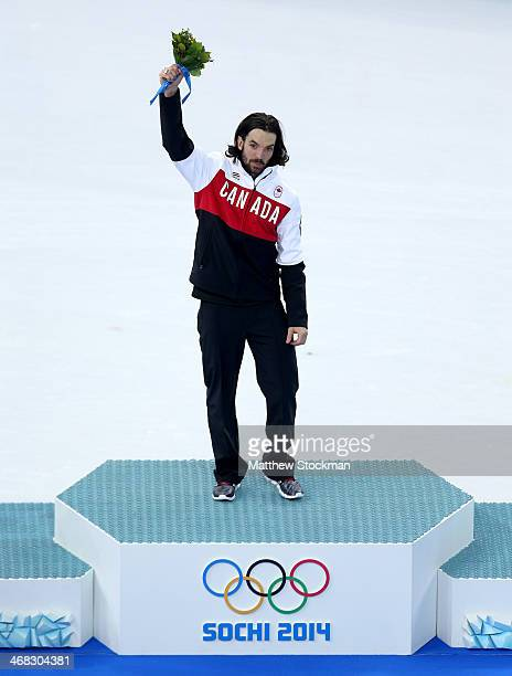 Gold medalist Charles Hamelin celebrates during the flower ceremony for the Short Track Men's 1500m Final on day 3 of the Sochi 2014 Winter Olympics...