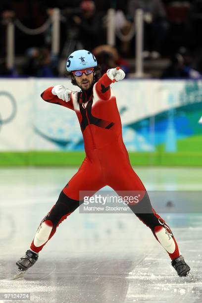 Gold medalist Charles Hamelin celebrates in the Men's 500m Short Track Speed Skating Final on day 15 of the 2010 Vancouver Winter Olympics at Pacific...